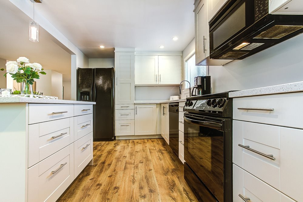 """Main Photo: 200 201 CAYER Street in Coquitlam: Maillardville Manufactured Home for sale in """"WILDWOOD PARK"""" : MLS®# R2175279"""