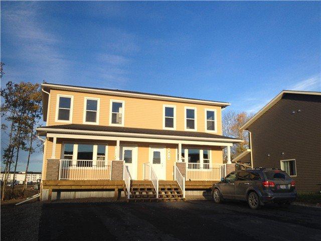 """Photo 1: Photos: 8404 88TH Street in Fort St. John: Fort St. John - City SE House 1/2 Duplex for sale in """"MATHEWS PARK"""" (Fort St. John (Zone 60))  : MLS®# N240216"""