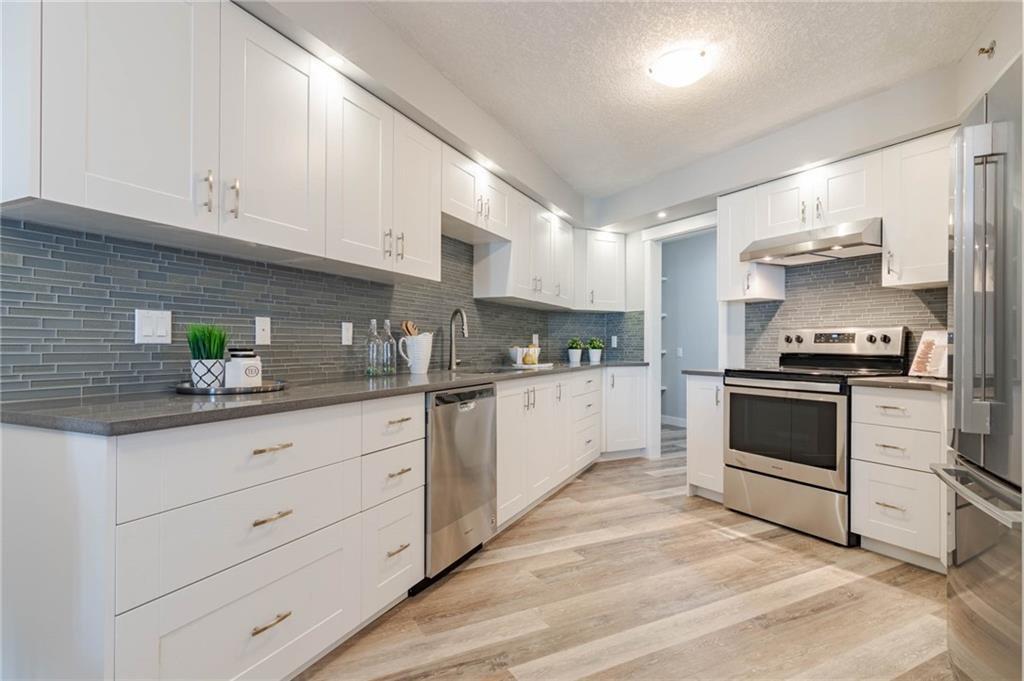 Main Photo: 422 7229 SIERRA MORENA Boulevard SW in Calgary: Signal Hill Apartment for sale : MLS®# C4272380