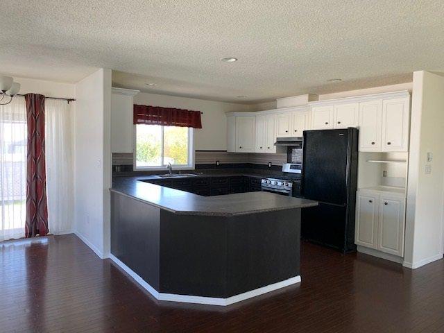 Photo 3: Photos: 10603 90 Street in Fort St. John: Fort St. John - City NE House for sale (Fort St. John (Zone 60))  : MLS®# R2406620