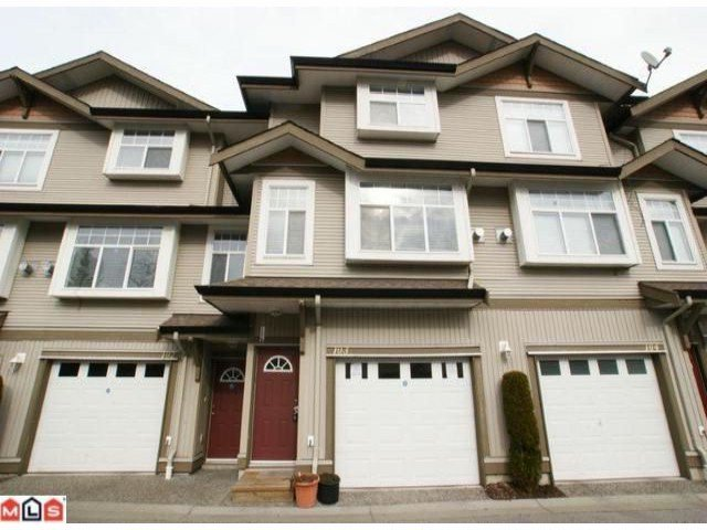 Main Photo: 103 9580 PRINCE CHARLES Boulevard in Surrey: Queen Mary Park Surrey Townhouse for sale : MLS®# F1115498
