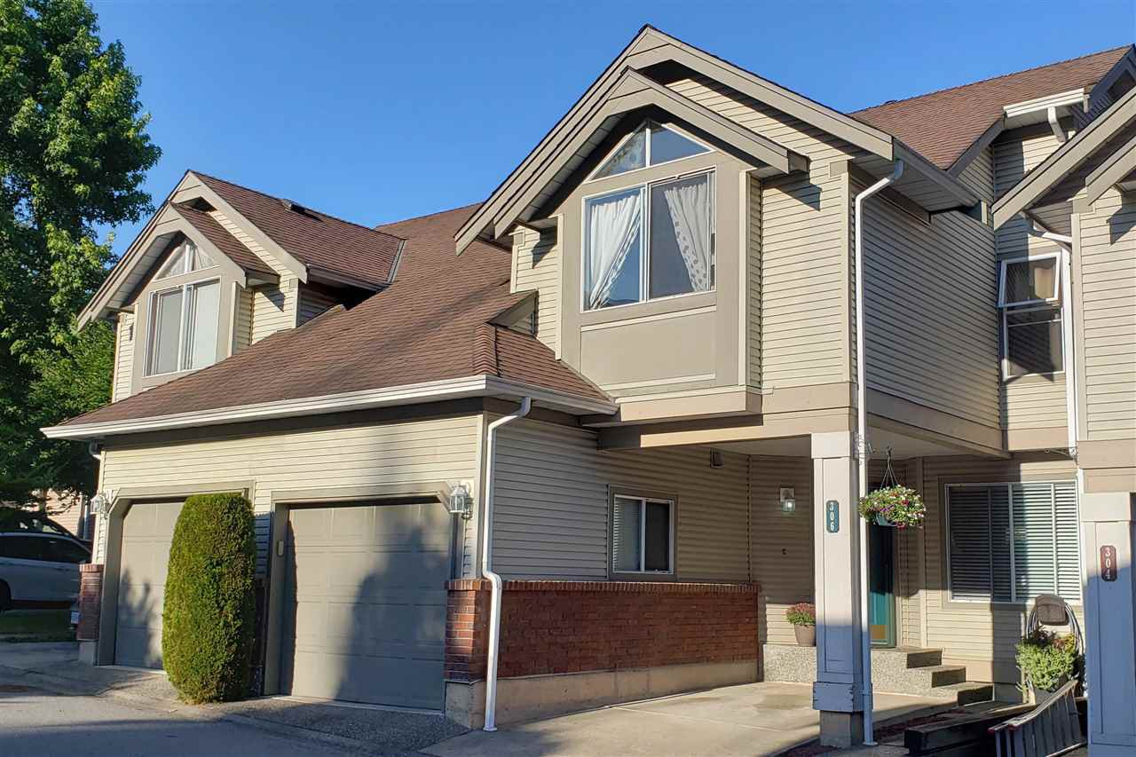 """Main Photo: 306 13900 HYLAND Road in Surrey: East Newton Townhouse for sale in """"Hyland Grove"""" : MLS®# R2485368"""