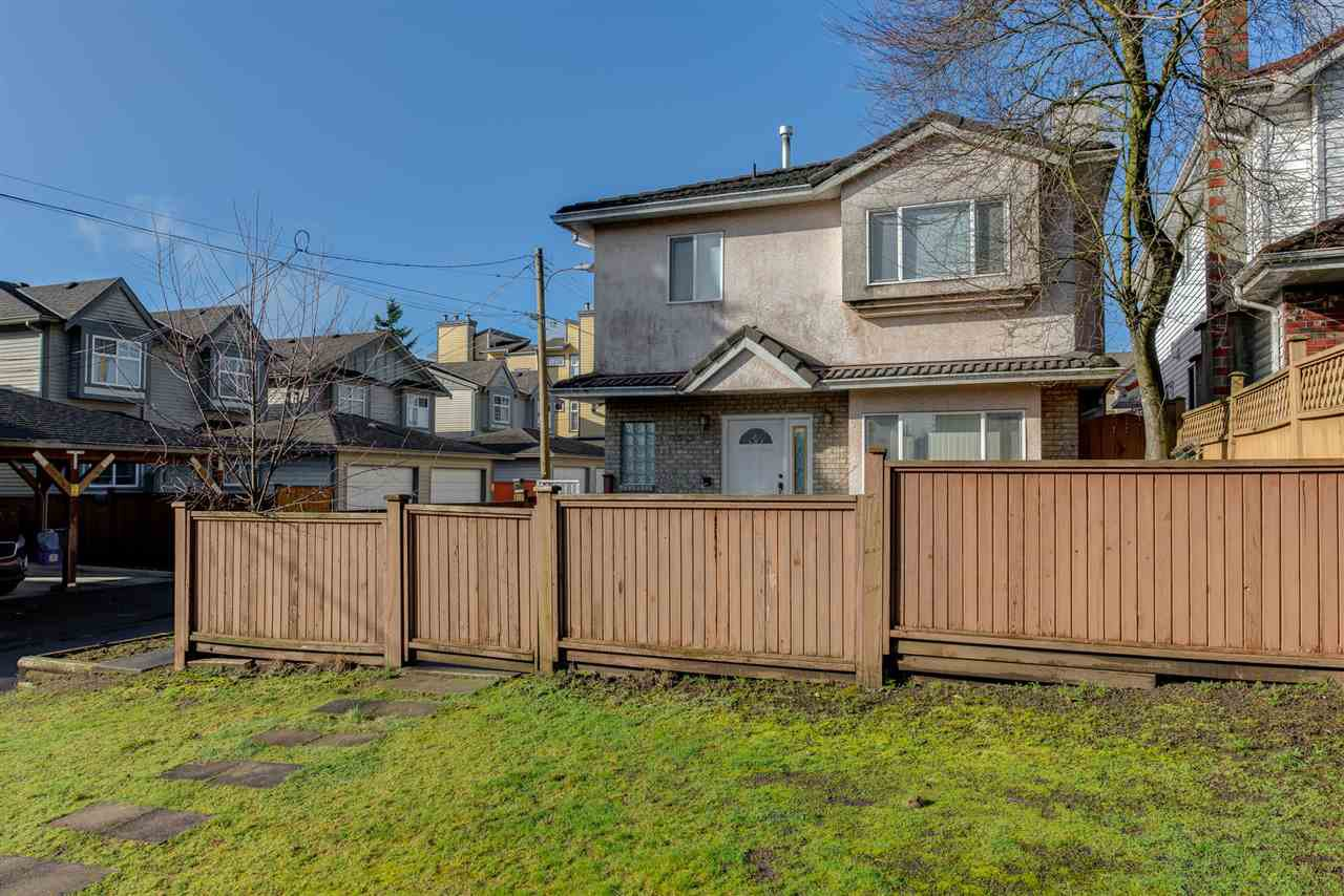 Main Photo: 8573 LAUREL Street in Vancouver: Marpole 1/2 Duplex for sale (Vancouver West)  : MLS®# R2036216