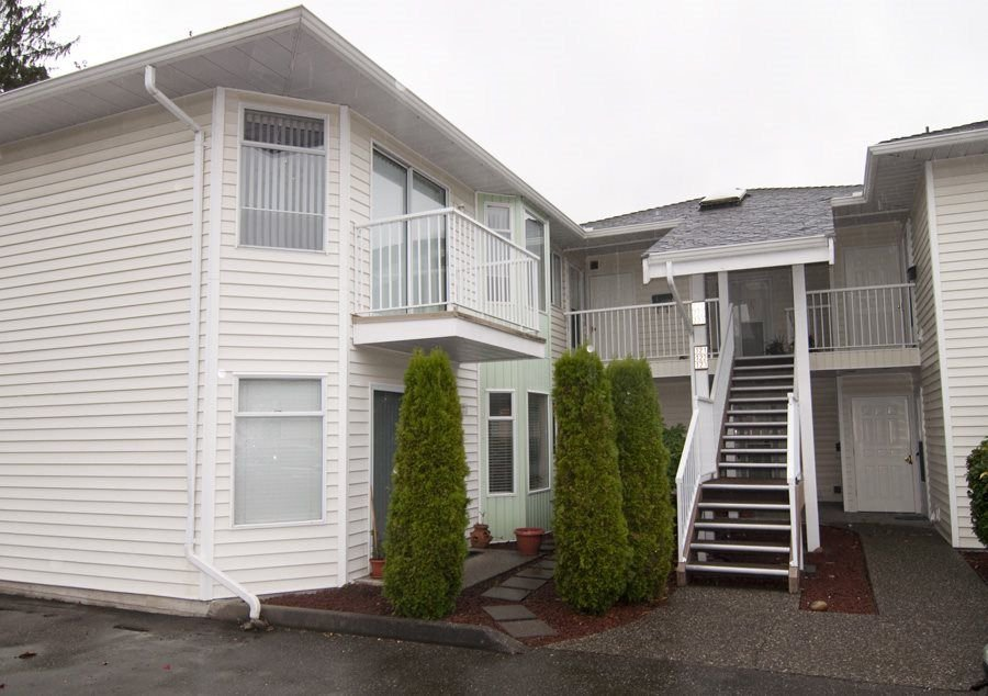"Main Photo: 221 7156 121 Street in Surrey: West Newton Townhouse for sale in ""Glenwood Village"" : MLS®# R2215838"
