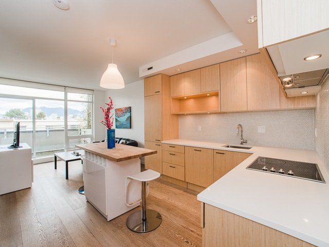 Kitchen features high end integrated appliances.