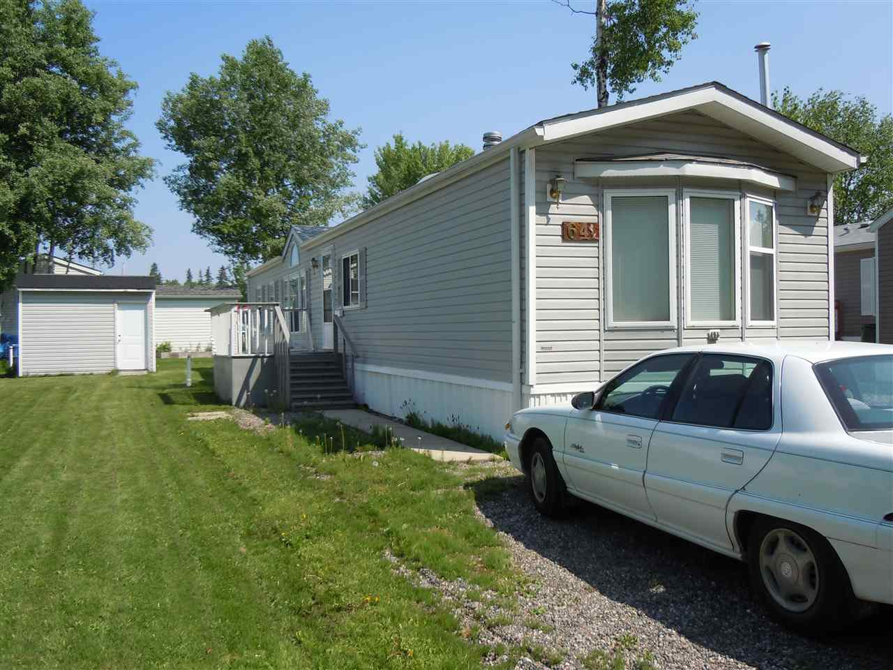 """Main Photo: 64 7817 S 97 Highway in Prince George: Sintich Manufactured Home for sale in """"SINTICH TRAILER PARK"""" (PG City South East (Zone 75))  : MLS®# R2375131"""