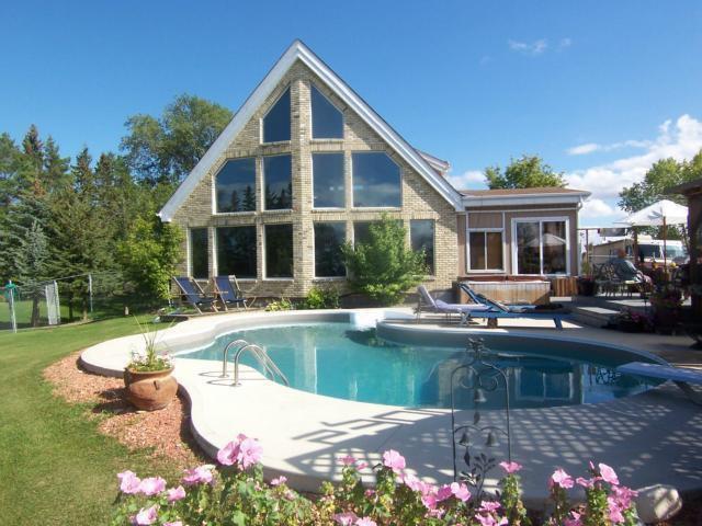 *Riverfront* A-Frame 2,330+/- sq.ft. w/inground pool