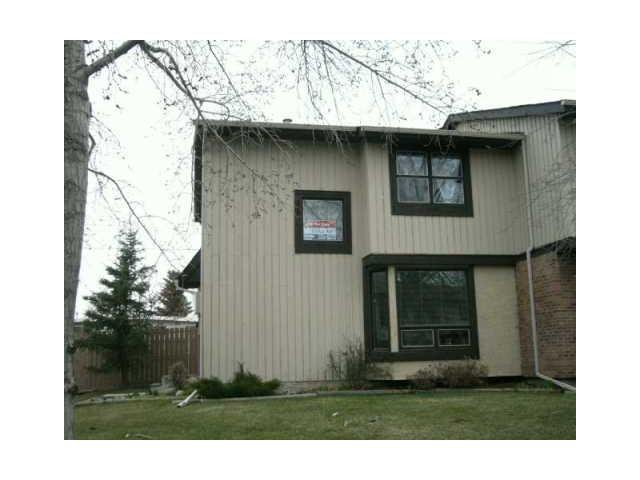 Main Photo: 53 123 QUEENSLAND Drive SE in CALGARY: Queensland Townhouse for sale (Calgary)  : MLS®# C3610862