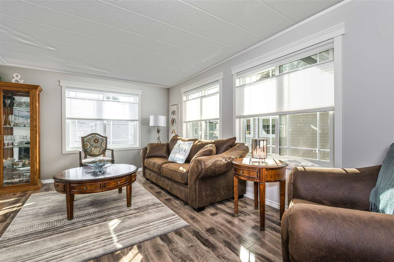 Embrace the natural light in your living room with a gorgeous laminate flooring and high end top-down/bottom-up blinds.