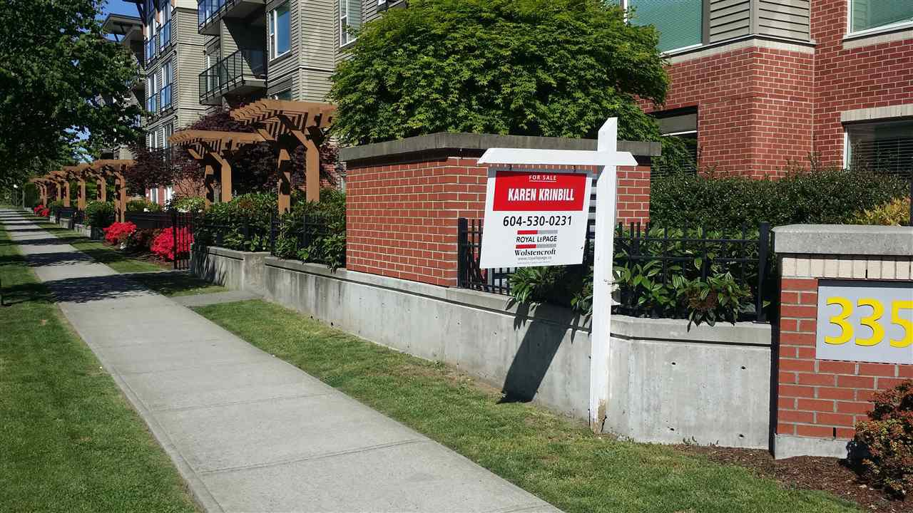 "Photo 1: Photos: 403 33538 MARSHALL Road in Abbotsford: Central Abbotsford Condo for sale in ""The Crossing"" : MLS®# R2159549"