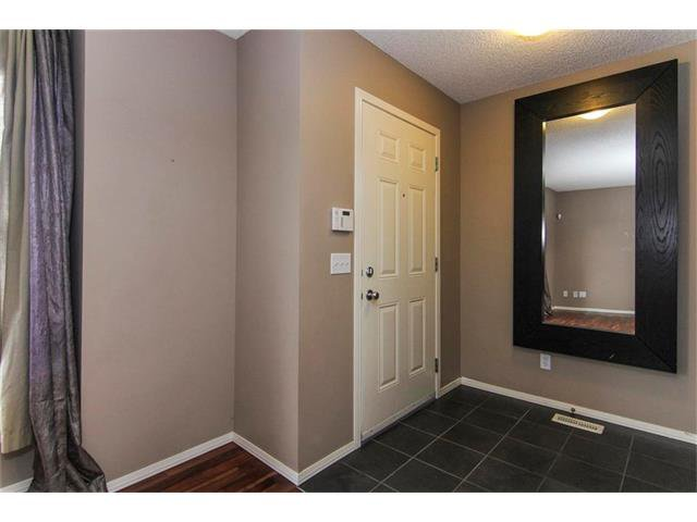Photo 2: Photos: 136 EVERSYDE Boulevard SW in Calgary: Evergreen House for sale : MLS®# C4081553
