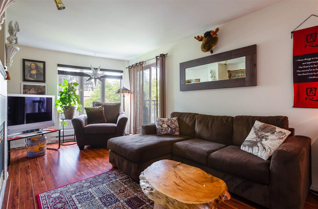 Spacious Living Room with new flooring and access to the covered balcony
