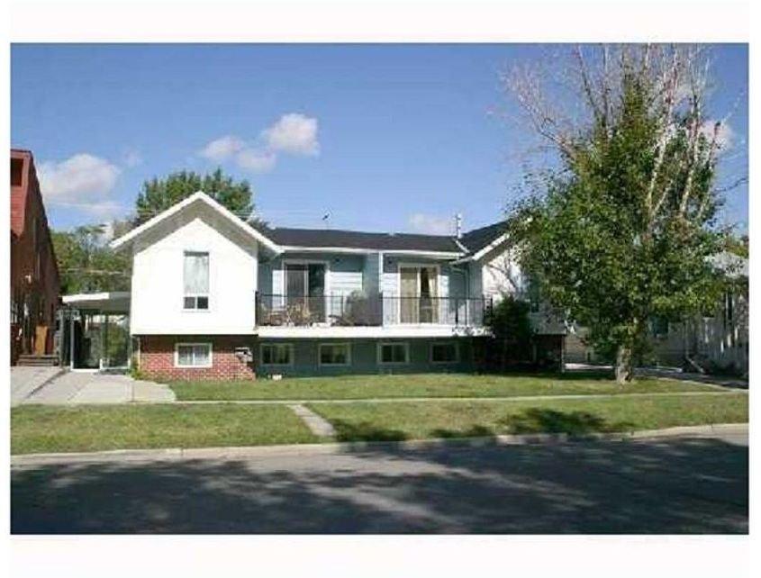 Main Photo: 220 50 Avenue: Claresholm Semi Detached for sale : MLS®# C4048339