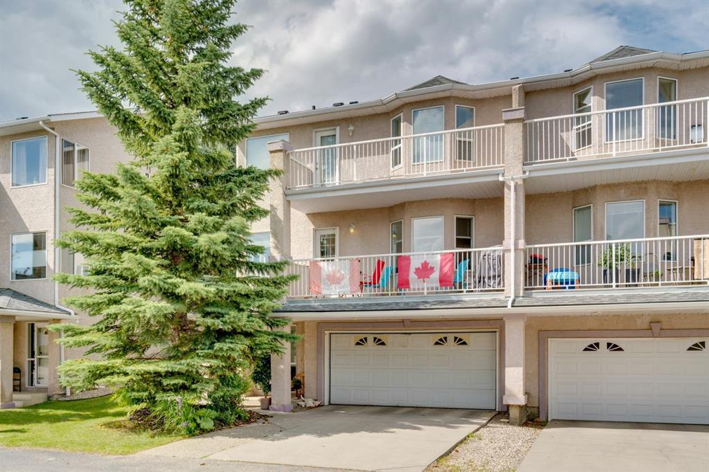 Main Photo: 321 SIERRA MORENA Green SW in Calgary: Signal Hill Row/Townhouse for sale : MLS®# A1014380