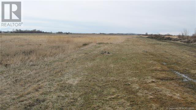 Main Photo: 28011 Township ROAD 372 in Rural Red Deer County: Retail for sale : MLS®# CA0188986