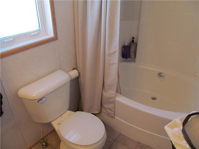 """Photo 4: Photos: 59 9203 82ND Street in Fort St. John: Fort St. John - City NE Manufactured Home for sale in """"COURTYARD MHP"""" (Fort St. John (Zone 60))  : MLS®# N224021"""