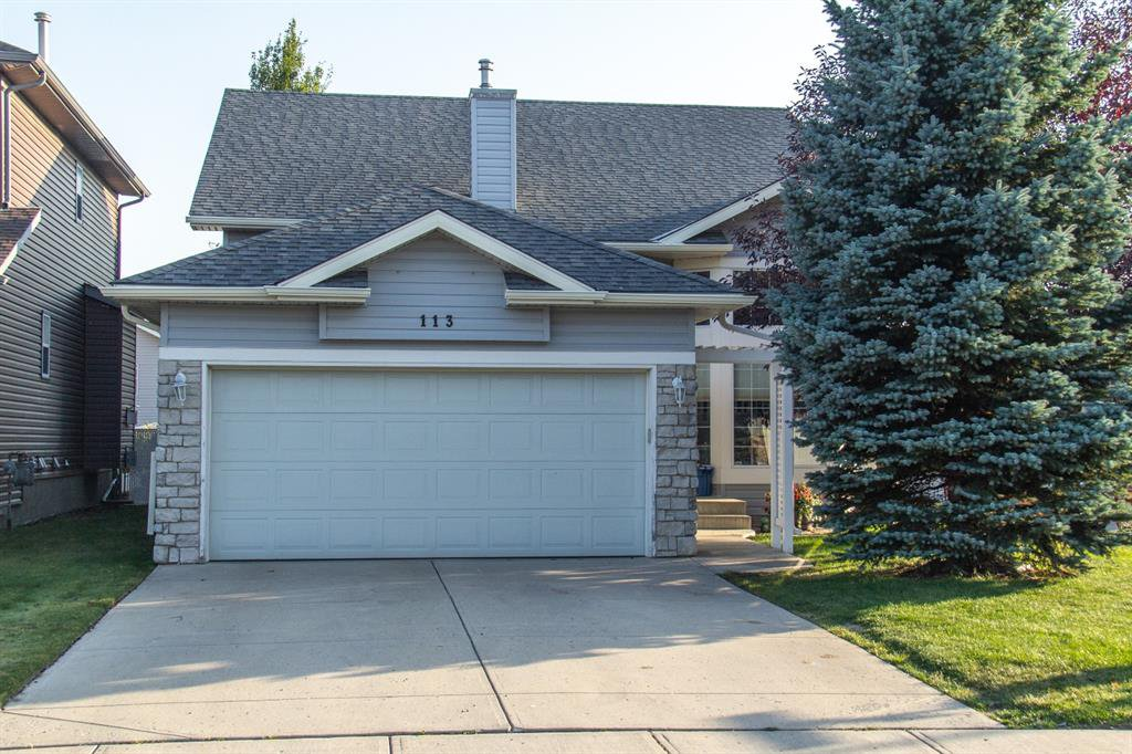 Photo 2: Photos: 113 Stonegate Place NW: Airdrie Detached for sale : MLS®# A1038026