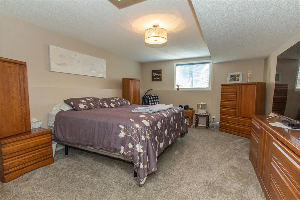 Photo 24: Photos: 113 Stonegate Place NW: Airdrie Detached for sale : MLS®# A1038026