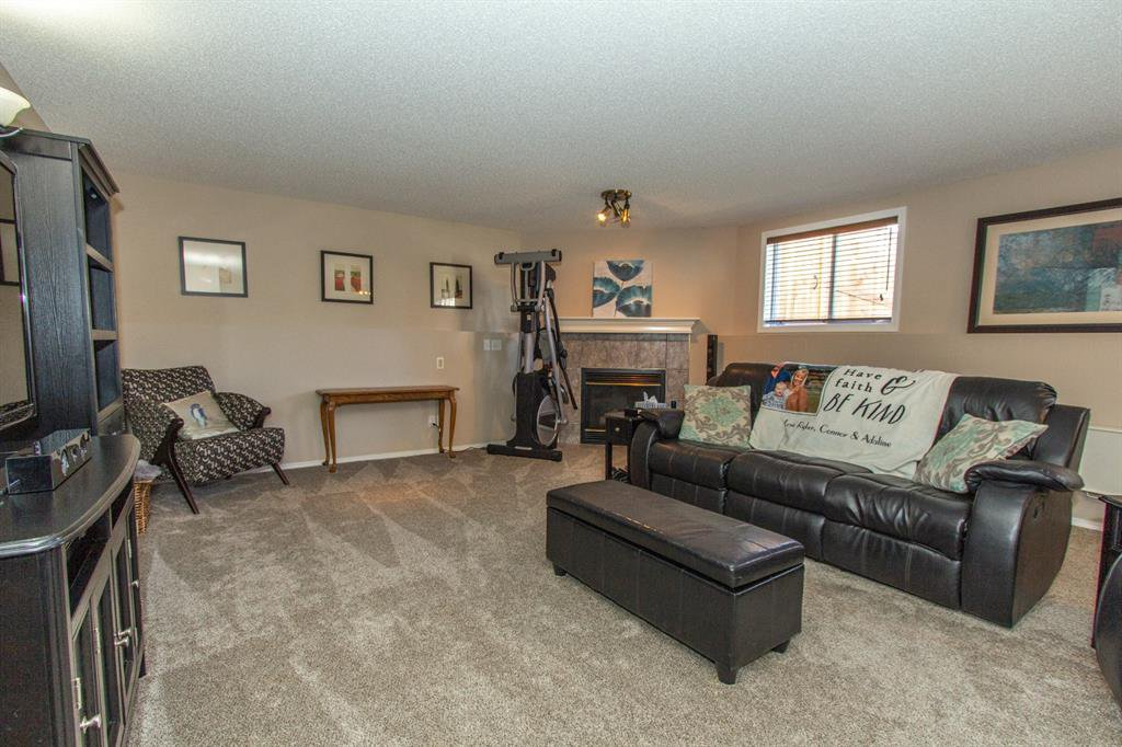 Photo 20: Photos: 113 Stonegate Place NW: Airdrie Detached for sale : MLS®# A1038026