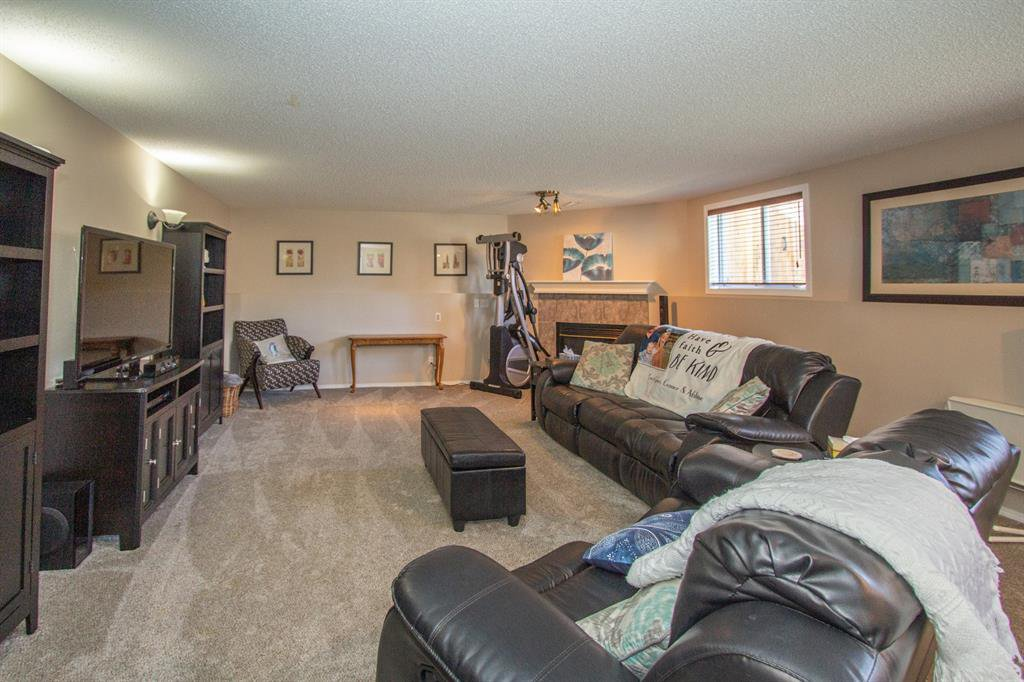 Photo 22: Photos: 113 Stonegate Place NW: Airdrie Detached for sale : MLS®# A1038026