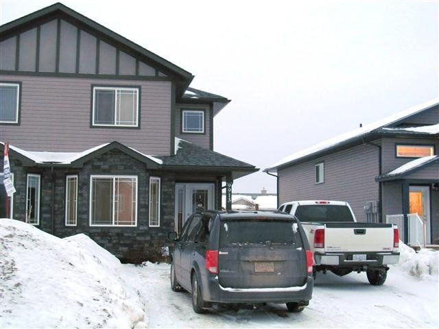 "Main Photo: 9913 117TH Avenue in Fort St. John: Fort St. John - City NE 1/2 Duplex for sale in ""EVERGREEN ESTATES"" (Fort St. John (Zone 60))  : MLS®# N224331"