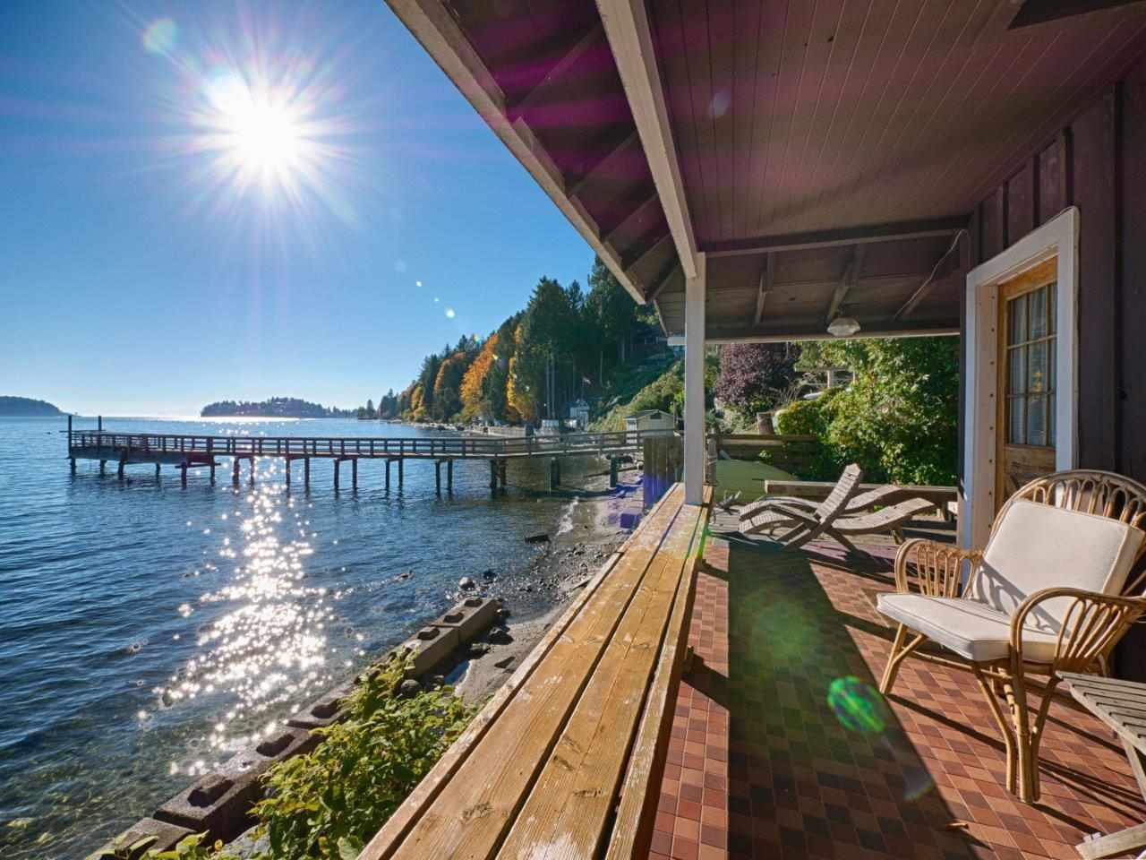 Right on the water!  Studio cabin has spectacular deck that overlooks the ocean.  The only way to get closer to the water is to be in it!