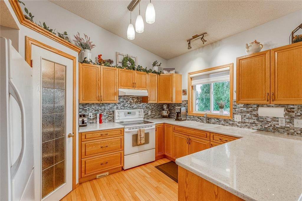 Photo 12: Photos: 14 BOW RIDGE Road: Cochrane Detached for sale : MLS®# C4305231