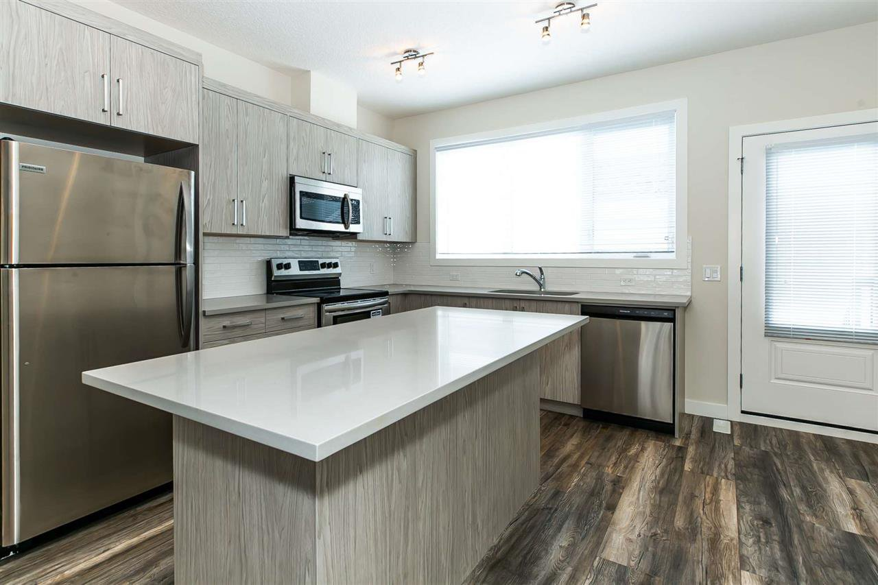 Main Photo: 1079 Gault Boulevard in Edmonton: Zone 27 Townhouse for sale : MLS®# E4192919