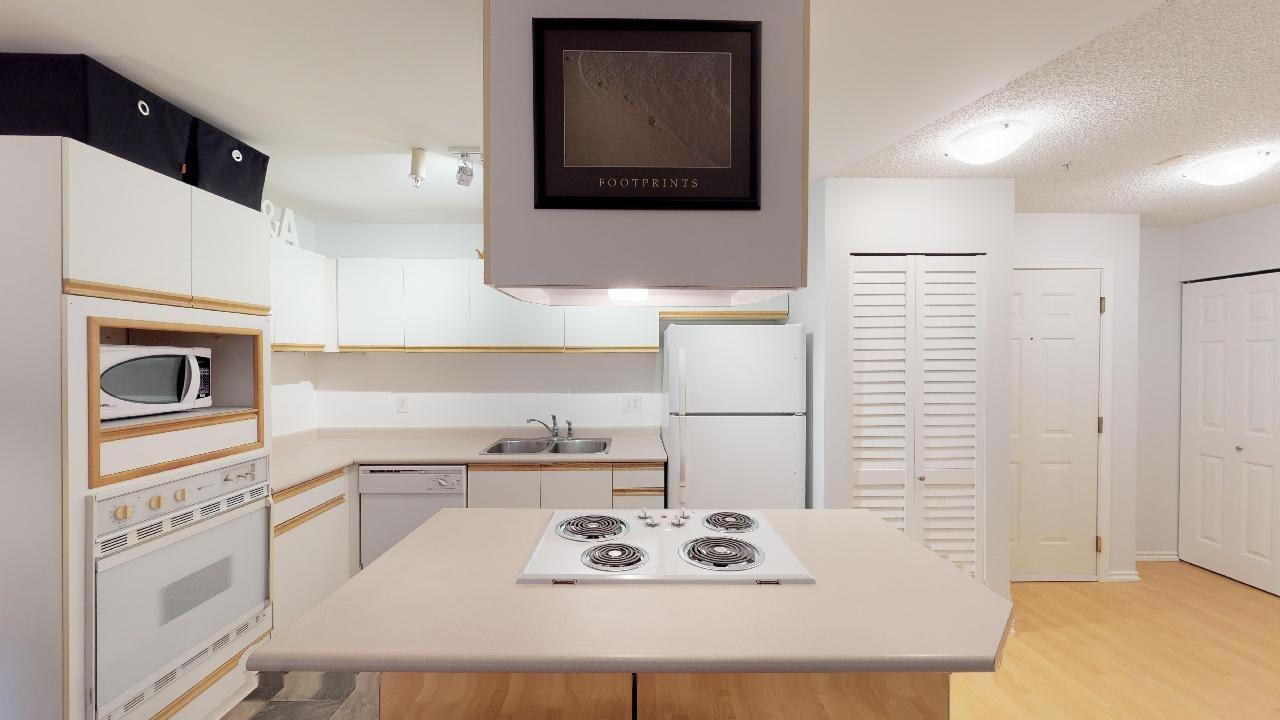 """Main Photo: A102 40100 WILLOW Crescent in Squamish: Garibaldi Estates Condo for sale in """"Diamondhead Place"""" : MLS®# R2408654"""