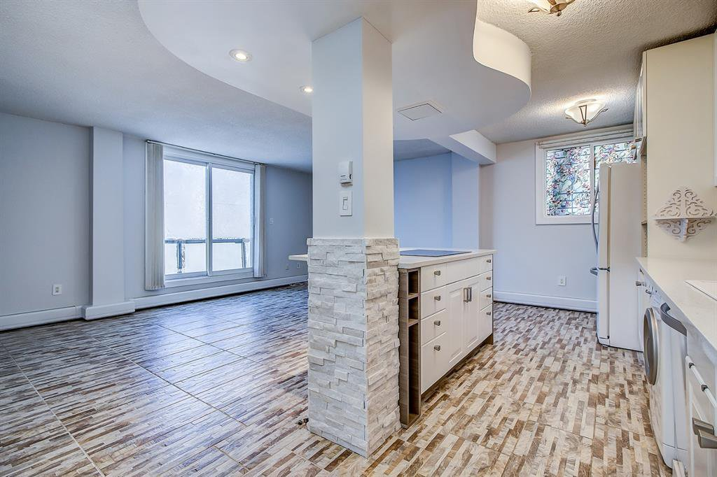 Photo 2: Photos: 303 2209 14 Street SW in Calgary: Bankview Apartment for sale : MLS®# A1048421
