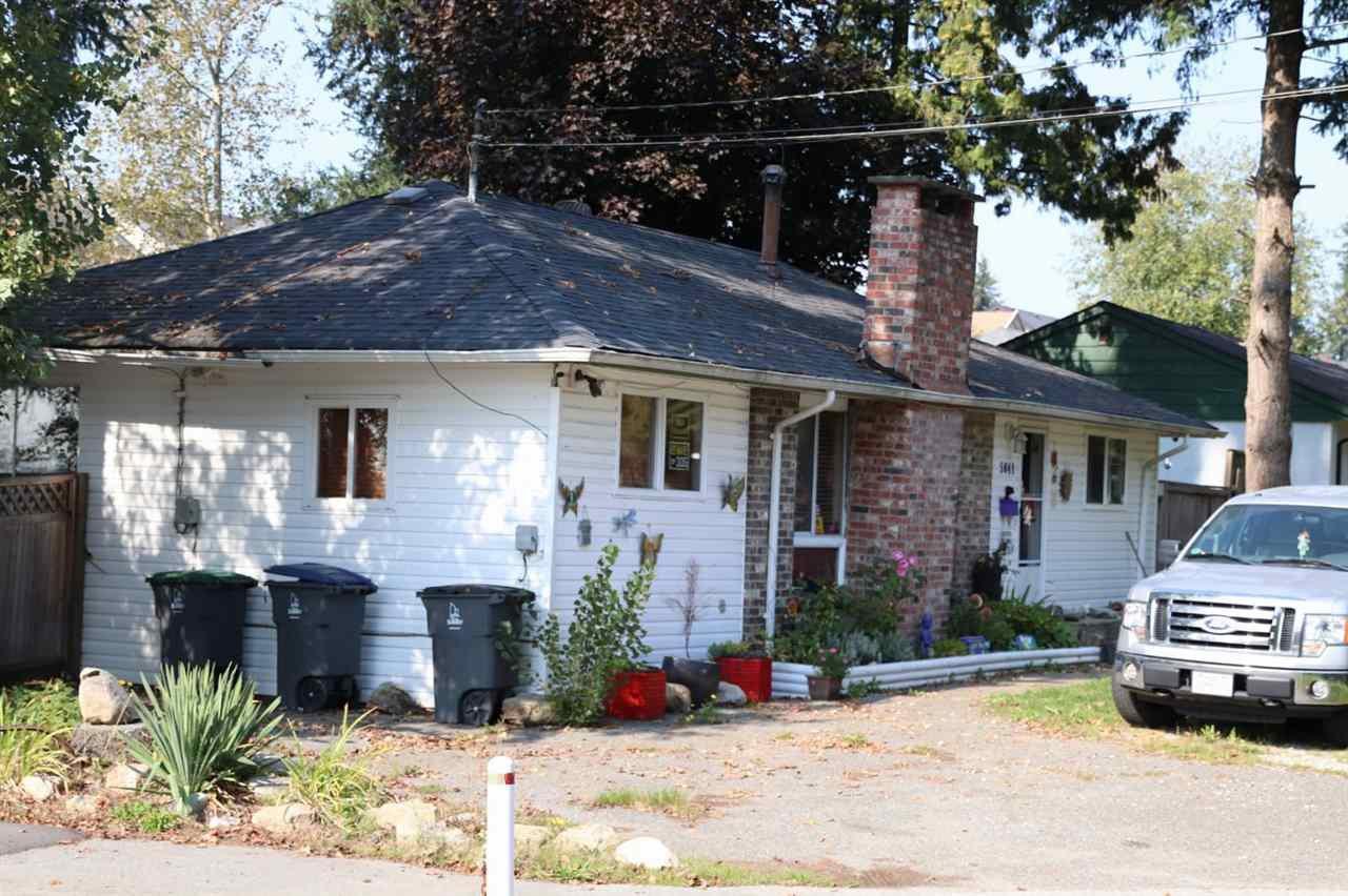 Main Photo: 5841 132ND Street in Surrey: Panorama Ridge House for sale : MLS®# R2504882