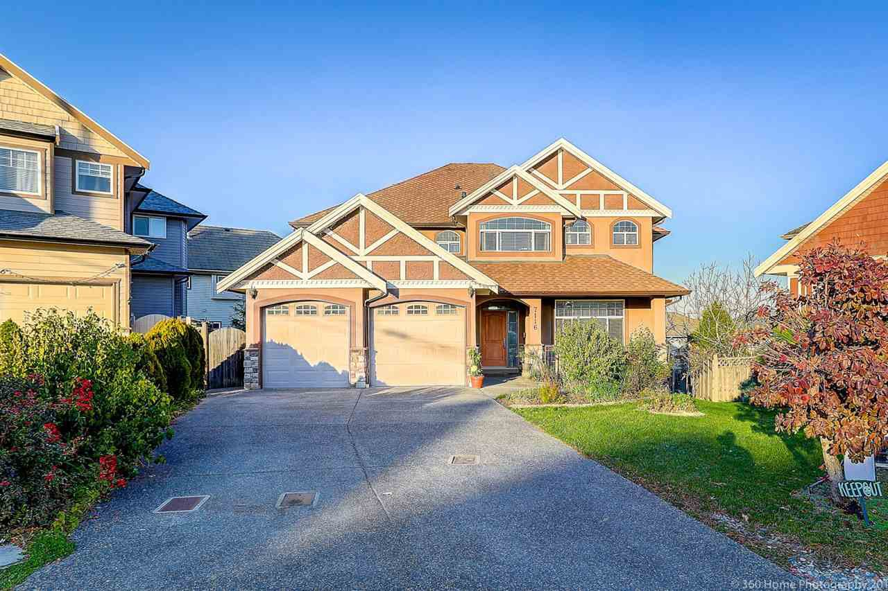 Main Photo: 7116 150 Street in Surrey: East Newton House for sale : MLS®# R2417754