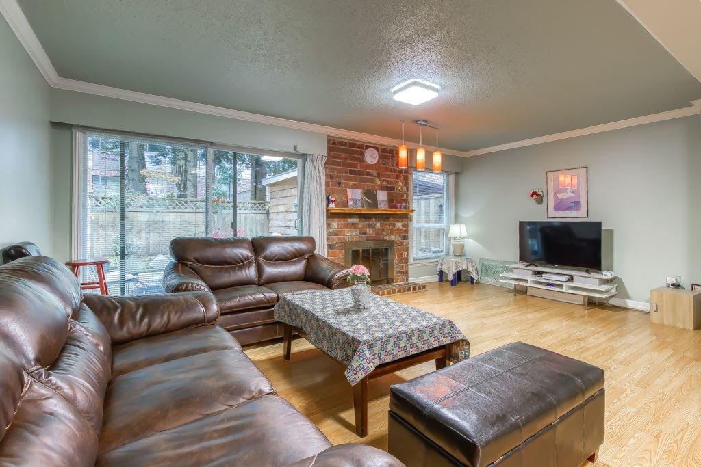"Main Photo: 214 13933 74 Avenue in Surrey: East Newton Townhouse for sale in ""GLENCO ESTATES"" : MLS®# R2517919"