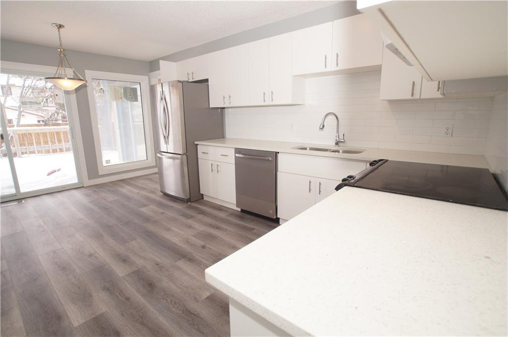 Photo 3: Photos: 56 TEMPLEWOOD RD NE in Calgary: Temple House for sale : MLS®# C4232506