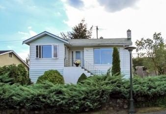 Incredible sweeping views of Fraser River from this very well maintained Massey Heights home