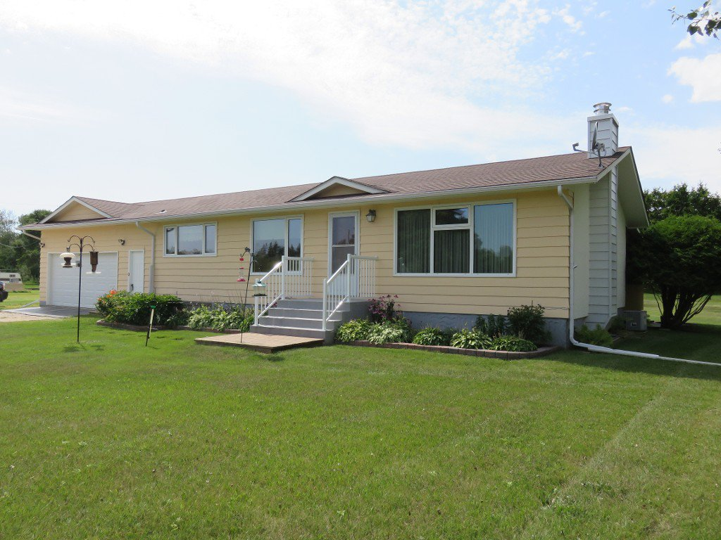 FABULOUS COUNTRY HOME! Ideal 1144 sf 2+ Bedroom Bungalow, Finished Basement, Rec Room, 3rd & 4th Bedrooms, AT2, Workshop on Mature Treed, Landscaped 8 Acre Lot on Paved Hwy. 12.