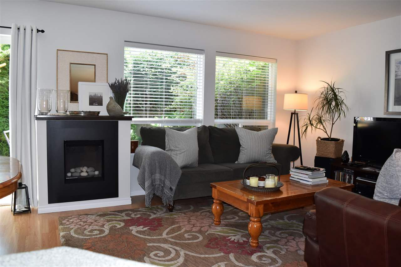 Spacious living is shares the natural gas fireplace with the dining area.