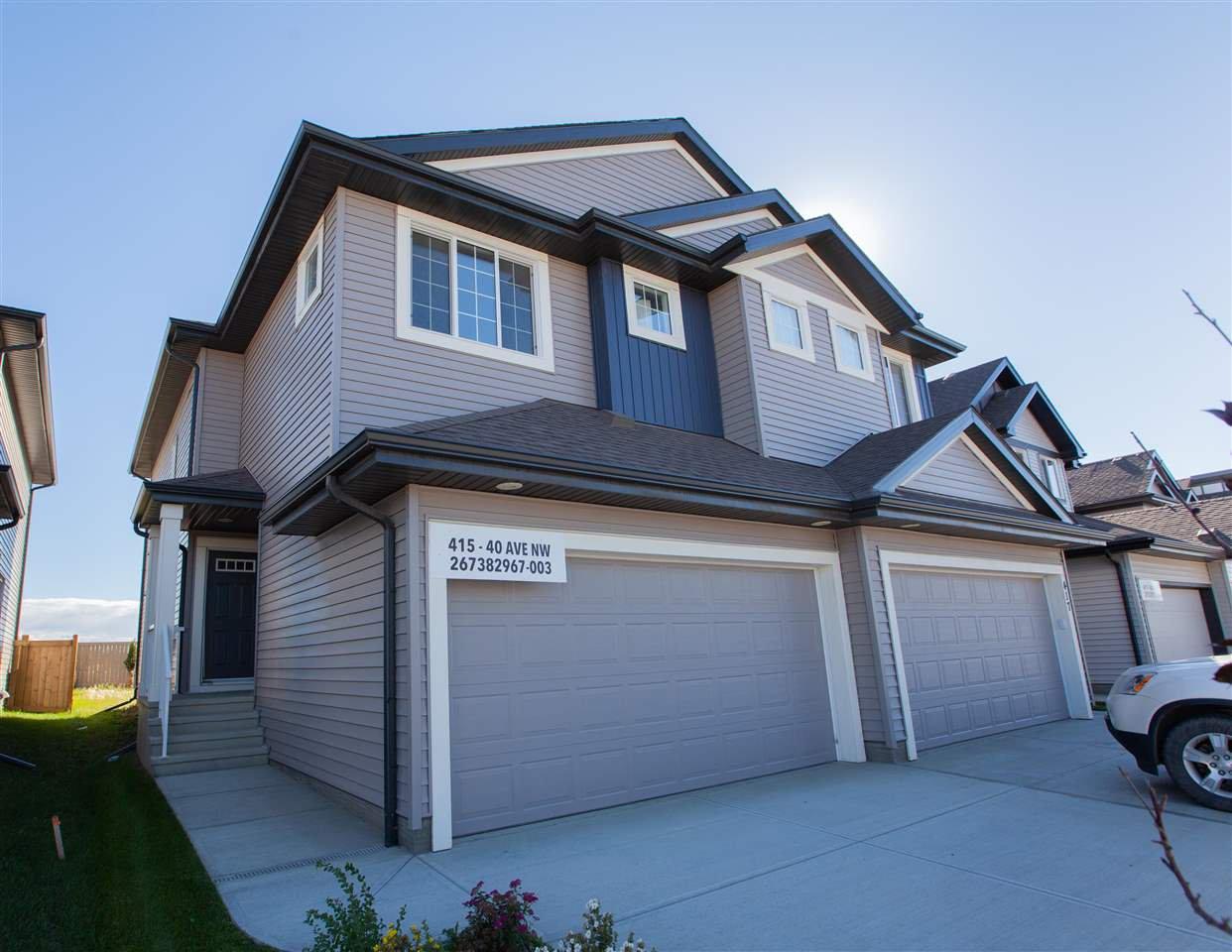 Main Photo: 415 40 Avenue NW in Edmonton: Zone 30 House Half Duplex for sale : MLS®# E4213920