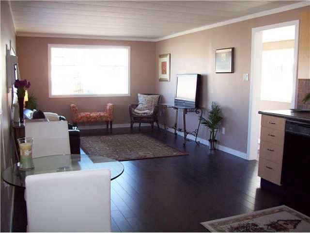 """Main Photo: 87 201 CAYER Street in Coquitlam: Maillardville Manufactured Home for sale in """"WILDWOOD PAKR"""" : MLS®# V991923"""
