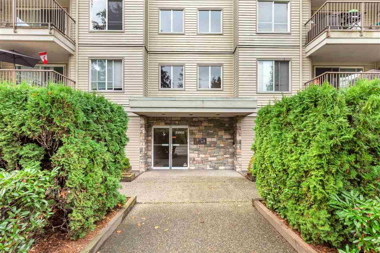 "Main Photo: 202 33502 GEORGE FERGUSON Way in Abbotsford: Central Abbotsford Condo for sale in ""Carina Court"" : MLS®# R2500932"