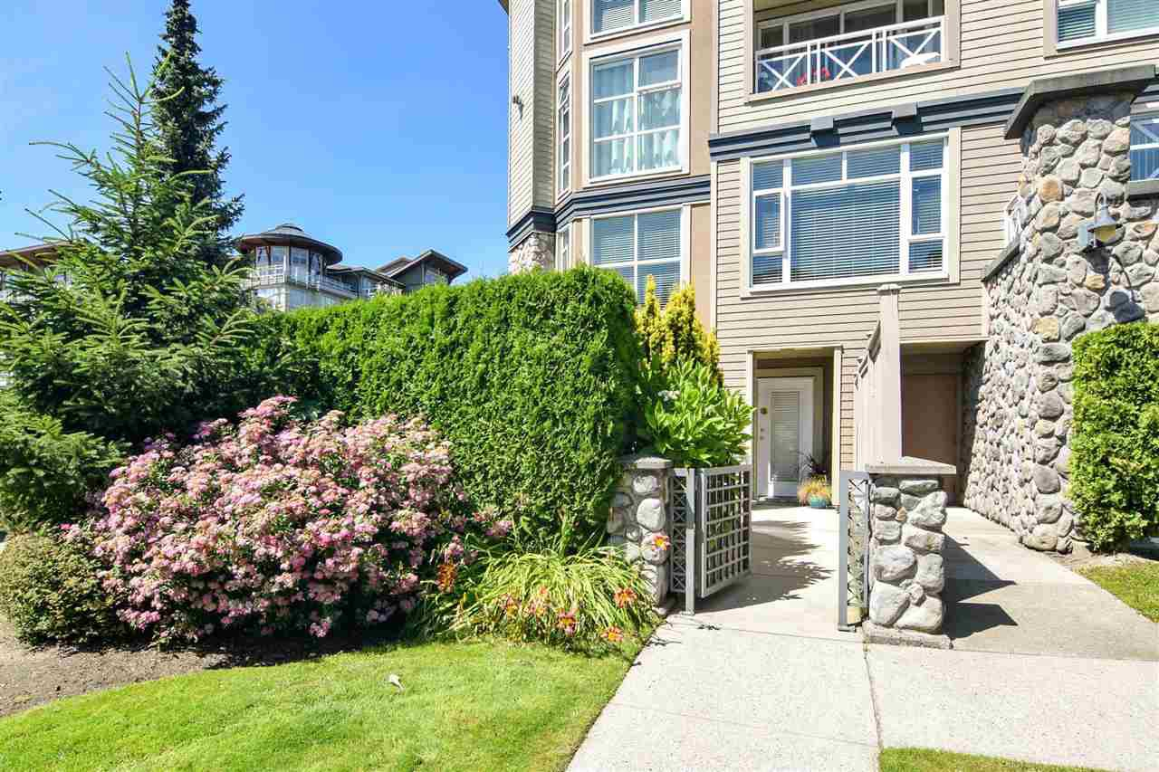 """Main Photo: 101 3600 WINDCREST Drive in North Vancouver: Roche Point Townhouse for sale in """"Windsong At The Raven Woods"""" : MLS®# R2476850"""