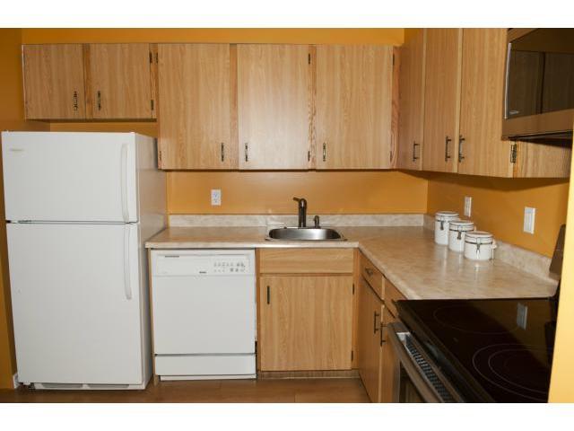 Photo 4: Photos: 650 Kenaston Boulevard in WINNIPEG: River Heights / Tuxedo / Linden Woods Condominium for sale (South Winnipeg)  : MLS®# 1218281