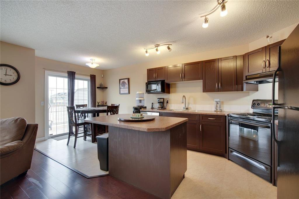 Main Photo: 108 371 Marina Drive: Chestermere Row/Townhouse for sale : MLS®# C4293360