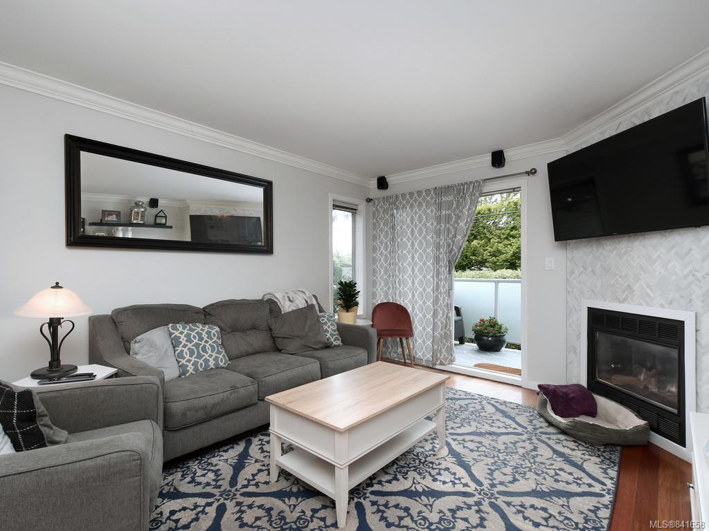 Light-filled living room with gas fireplace