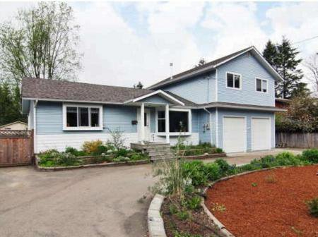 Main Photo: Extensively Updated Family Home With Master Bedroom On Main Floor