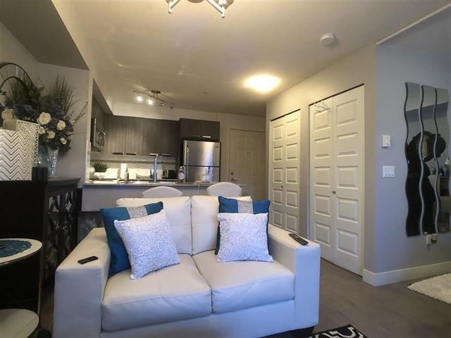 Main Photo: 506 13883 LAUREL Drive in Surrey: Whalley Condo for sale (North Surrey)  : MLS®# R2463277