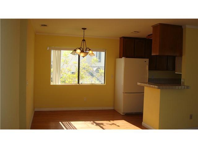 Main Photo: LINDA VISTA Condo for sale : 2 bedrooms : 6660 Glidden Street in San Diego