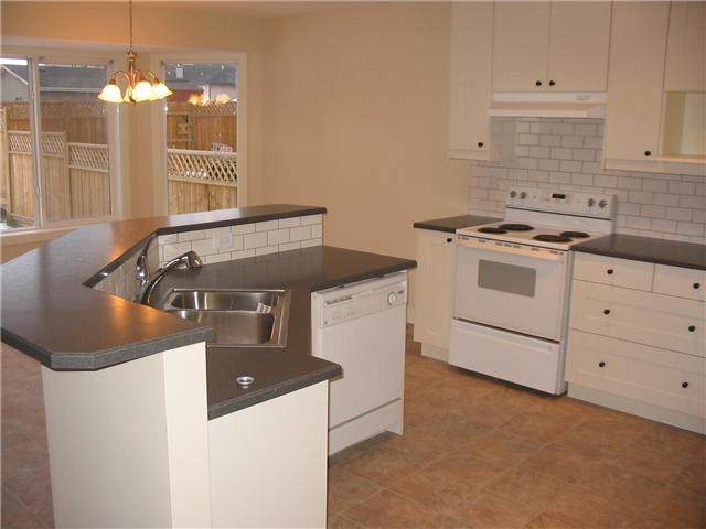 Photo 7: Photos: 106 TARALAKE Way NE in CALGARY: Taradale Residential Detached Single Family for sale (Calgary)  : MLS®# C3546779