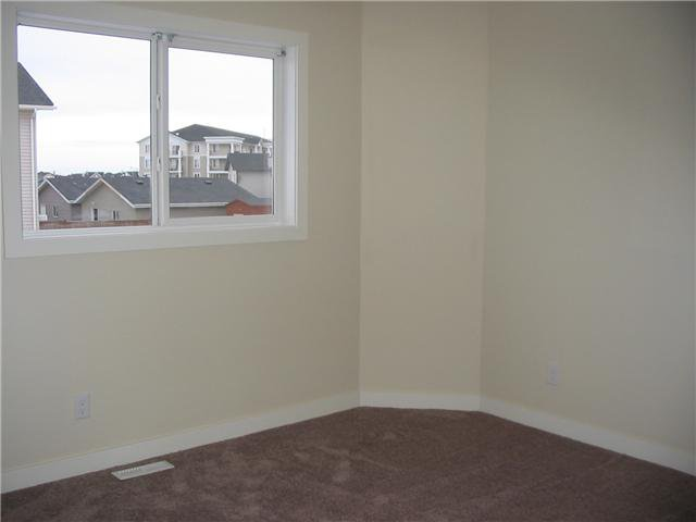 Photo 13: Photos: 106 TARALAKE Way NE in CALGARY: Taradale Residential Detached Single Family for sale (Calgary)  : MLS®# C3546779