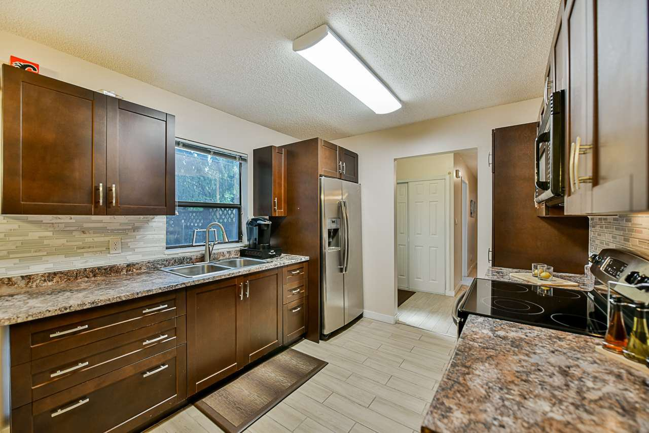 Main Photo: 101 7064 133B Street in Surrey: West Newton Townhouse for sale : MLS®# R2410637